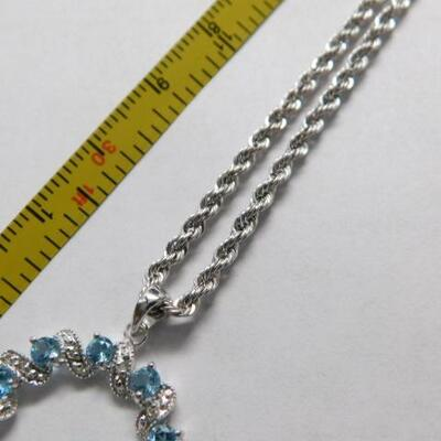 14 KT White Gold Circle Topaz and Diamond Pendant on 14KT Gold Rope Chain 4 grams