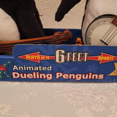 Lot 181: Animated Penguin & Dueling Penguins