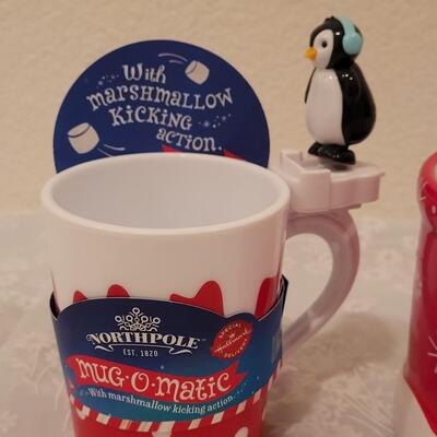 Lot 195: Christmas Coca-Cola Coffee Cup and Marshmallow Kicking Penguin Hot Cocoa Mug