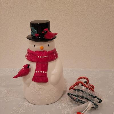 Lot 204: Snowman Cookie Jar and Cookie Cutters
