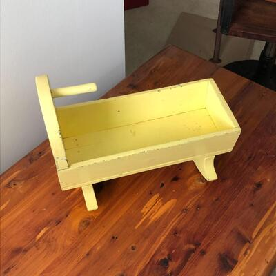 Lot 20 - Antique Yellow Doll Cradle