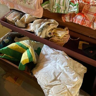 Blanket chest full of baby linens, clothes and other
