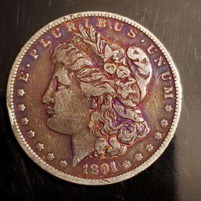 1891  P Rainbow toned morgan silver dollar .This coin has some colorful toning.