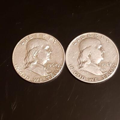 2 silver Franklin half dollars