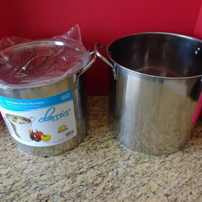 LOT 781  TWO STAINLESS STEEL POTS