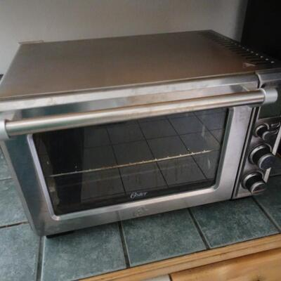 LOT 789. OSTER CONVECTION OVEN