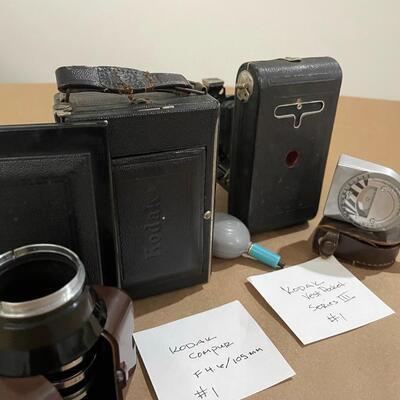 Kodak Folding Pocket Cameras with accessories.