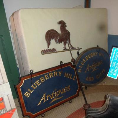 Copper rooster weather vane and antique signs
