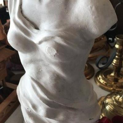 Pottery statue of woman's torso