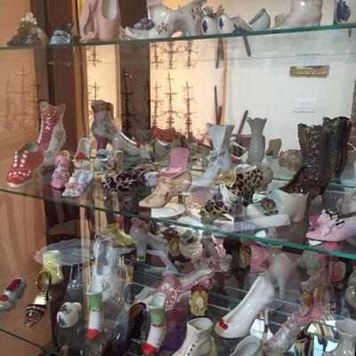 Large collection of porcelain and ceramic shoes.