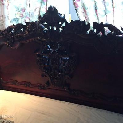 Beautifully engraved wooden bed.