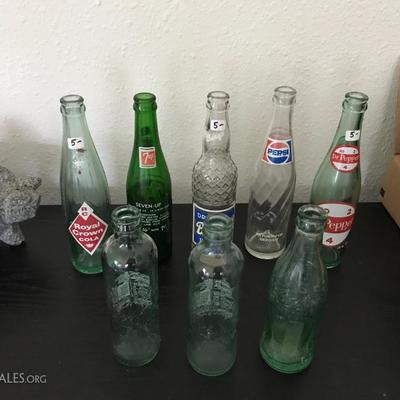 Vintage glass pop (soda) bottles. 3 Coca-Colas, Dr Pepper, Royal Crown Cola, 7up, Pepsi, ...Price at estate sale: $5 each