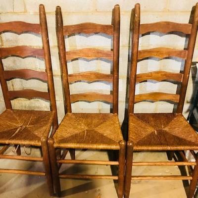 High back cane chairs.