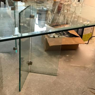 Sleek and modern beveled glass top and base dining table.
