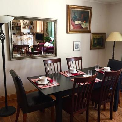 Decorative standing lamps, wood dining chairs, leather dining chairs, large mirror, Martha Stewart dishes, window treatments