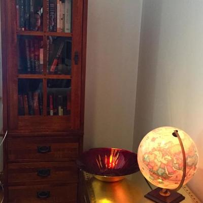 Mission-style bookcases, world globe lamp.