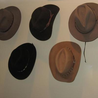 Large collection of cowboy hats and boots