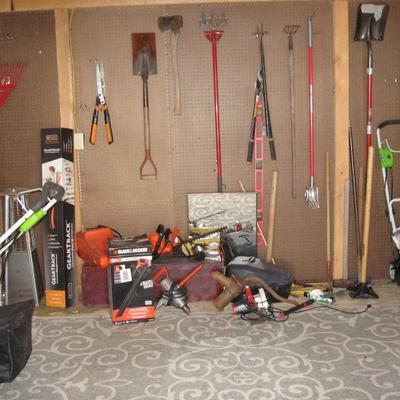 Shed full of lawn equipment and power tools