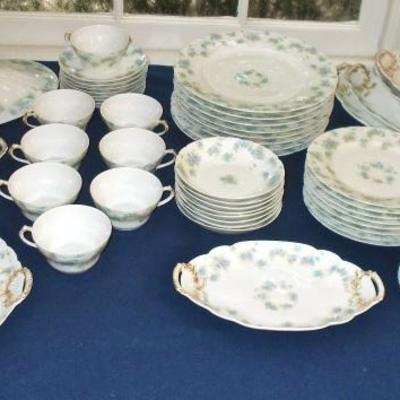 Mid 1800's Haviland Limoge handpainted with bachelor buttons set of china in pristine condition $5,200; has a reserve