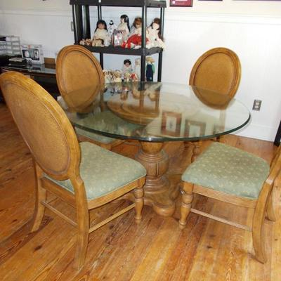 Chair $55 each four available Glass top dining table $440