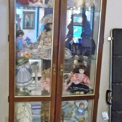 Lighted glass curio cabinet $265