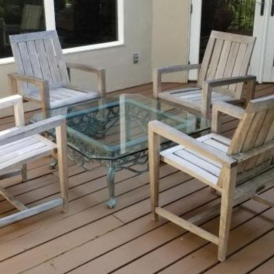 Kingsley Bate. Genuine teak chairs @ $125 each. Center glass and iron Mexican table @ $125.