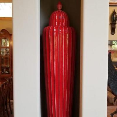 These extra large lidded red fluted jars are worth between $550 - $750 each. (We have 2) Each are over 4 feet tall!...