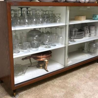 Mid Century display cabinet with sliding glass doors.