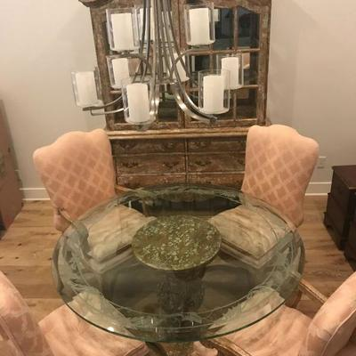 Custom made dining table and chairs. Two are captain's chairs and 2 without arms. Glass weighs A LOT. Originally purchased for $6,000....