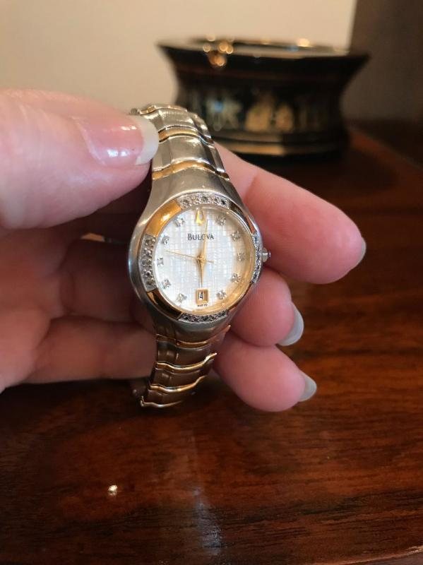 All jewelry reviewed and detailed by Jewelry Appraiser: BULOVA 18K GOLD, MOTHER OF PEARL AND DIAMONDS. $450