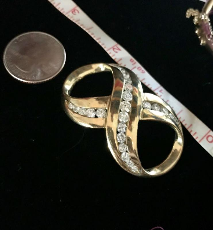 All jewelry reviewed and detailed by Jewelry Appraiser: SCARF HOLDER. 14K GOLD WITH 3.85 CT DIAMONDS. 25 DIAMONDS. $3,850