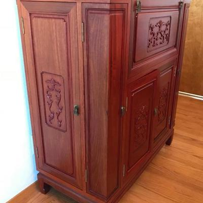 Imported from China in early 1980's Hand Carved Solid Rosewood Liquor Cabinet & Server When The Lid Is Raised, Two Serving Areas Flip...
