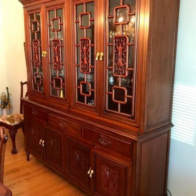 Imported from China in early 1980's Hand Carved Solid Rosewood Furniture With Gold Accent Hardware. Display cabinet with lighting