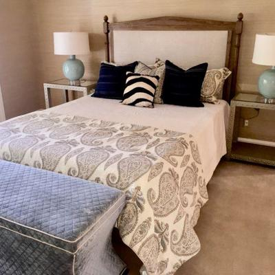 Queen Size bed with wooden frame, headboard, base and box springs.