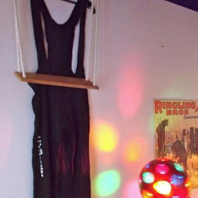 2 Trapeze jumpsuits $25 each Tall brass globe ball light $75 Trapeze swing $30