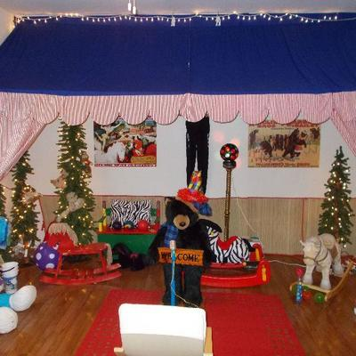 Canopy  & window treatment $275 zebra pillows $12 each Red rug $55 Tall bear $125 Microphone
