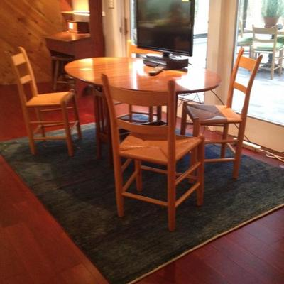 Rosewood round kitchen table with 4 hand made cain high back chairs