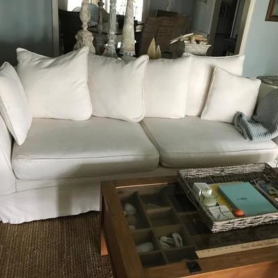Sofa with 2 sets of slip covers and 5 pillows $249 8' X 31