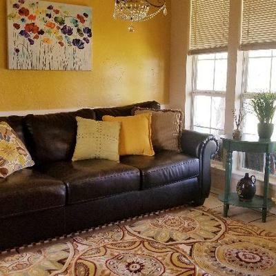 Ashley Leather Sofa (retail $2,500)   $400 Rug  $45