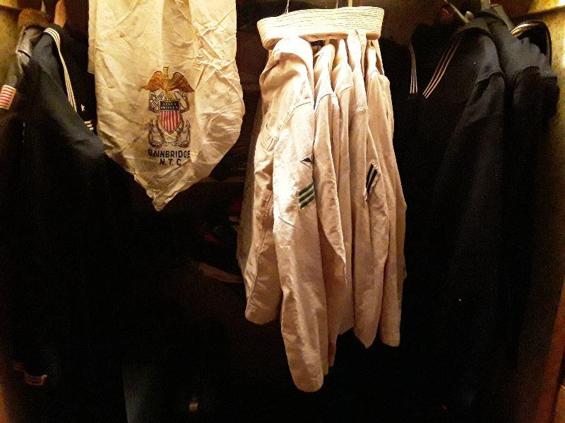 1 naval bucket hat & 1 military scarf. There are a few other War Era Memoribilia.