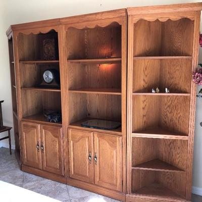 Four-section oak finish display shelves, sold separately or together - $495 (Includes 2 end/corner 5-shelf units - $55 EA, 2 wall units...