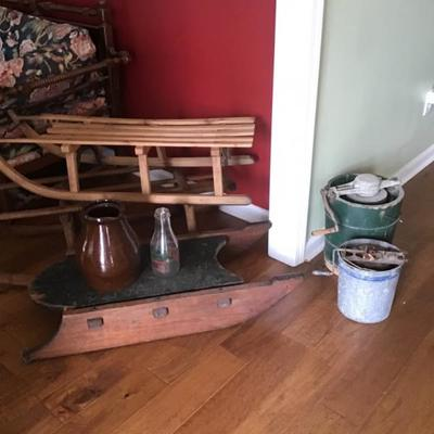 Wooden sleds and ice cream churns