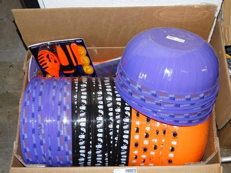 Box of halloween bowls and pumpkin carving kits.