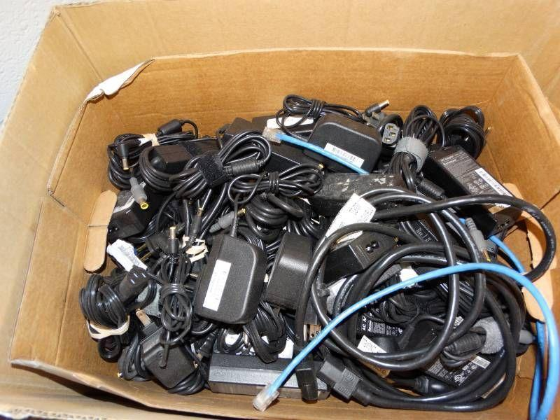 Large lot of ac adapters and chargers.