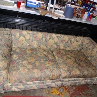 Couch, missing back cushions.