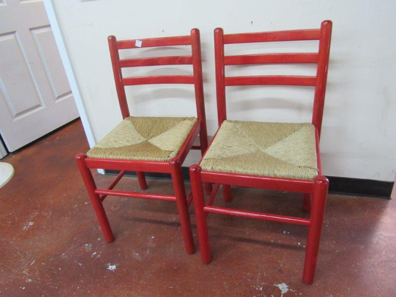 2 red painted rush seat chairs