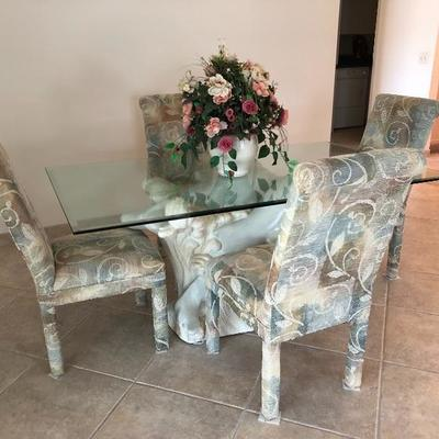 Rectangular glass-top dining table with porpoise base and 4 upholstered parsons chairs - 42