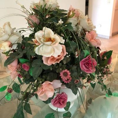 Several colorful faux flower/greenery arrangements.