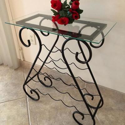 Metal wine rack with glass top