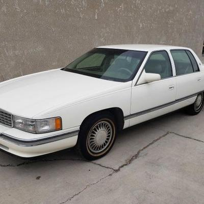 #137: 1995 Cadillac Deville White, Low Miles! See Video! VIN: 1G6KD52B2SU271147 Mileage: 61,558 Cold A/C. Leather interior. Power...